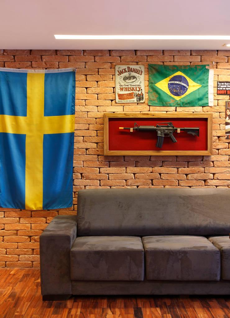 Apartamento Solteiro: Salas de estar modernas por Carolina Mendonça Projetos de Arquitetura e Interiores LTDA