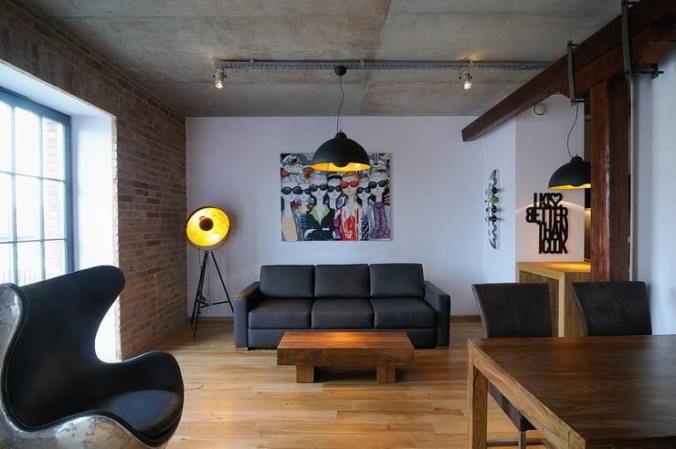 Loft w młynie.: styl , w kategorii Salon zaprojektowany przez ARTEMA  PRACOWANIA ARCHITEKTURY  WNĘTRZ ,