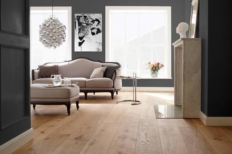 Walls & flooring by BAUWERK PARQUET