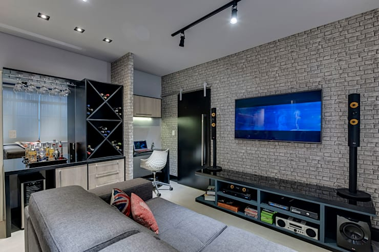 Living e Home Theather: Salas de estar  por Guido Iluminação e Design
