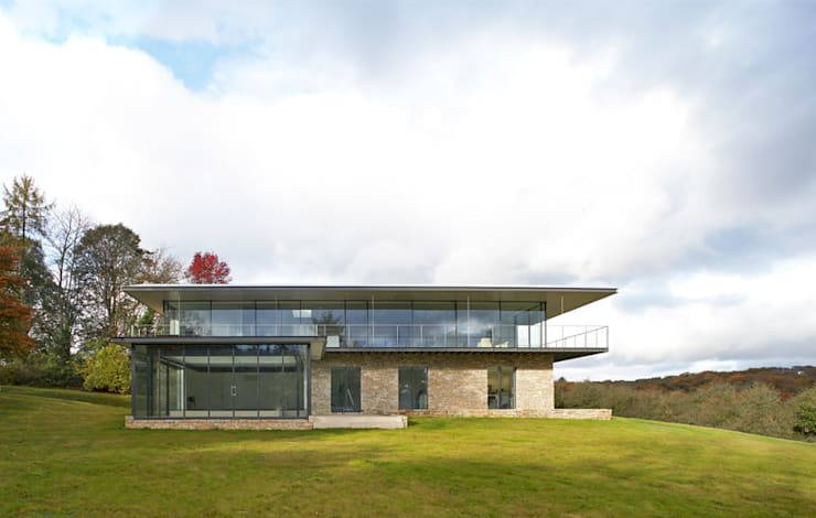 Stone House: modern Houses by The Manser Practice Architects + Designers