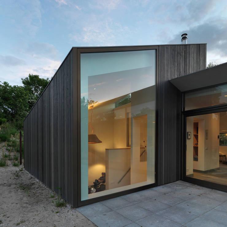 Vakantiewoning Dockboot, Schiermonnikoog: landelijke Huizen door De Zwarte Hond