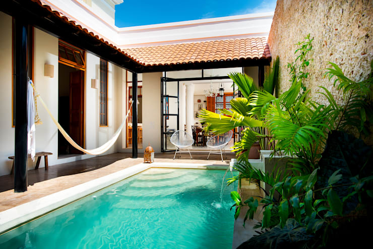Casa GC55: Jardines de estilo ecléctico por Taller Estilo Arquitectura