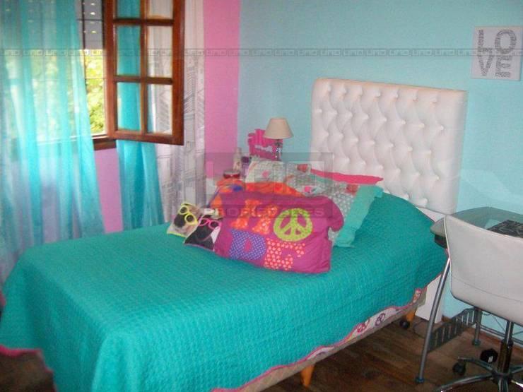 San Lorenzo y Alsina: Dormitorios infantiles de estilo  por Uno Propiedades,Moderno