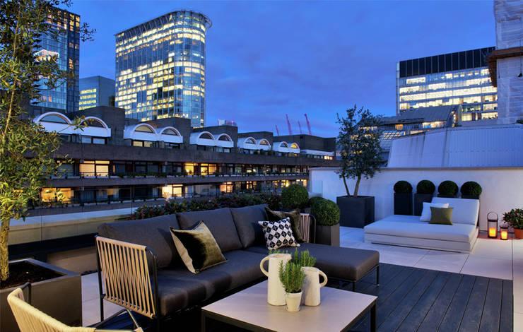 Balcones, porches y terrazas de estilo  por The Manser Practice Architects + Designers
