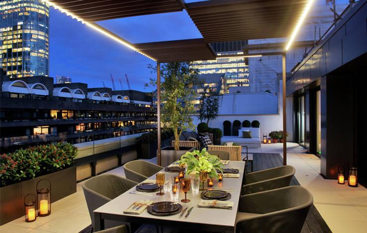 Terrazas de estilo  por The Manser Practice Architects + Designers