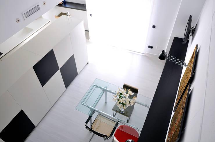 Interiorismo de un piso en Girona: Comedores de estilo  de FAA Fraguell Arquitectes Associats, scp