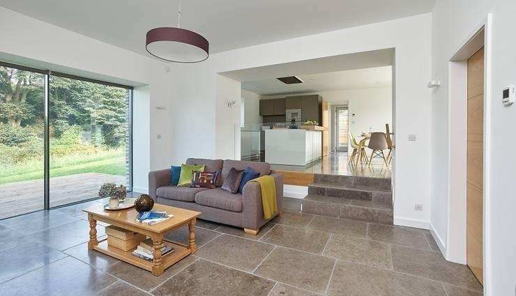 1st Sitting room / Kitchen: modern Living room by David Village Lighting