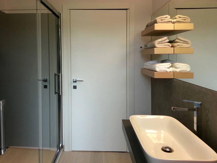 Banheiros  por studio radicediuno