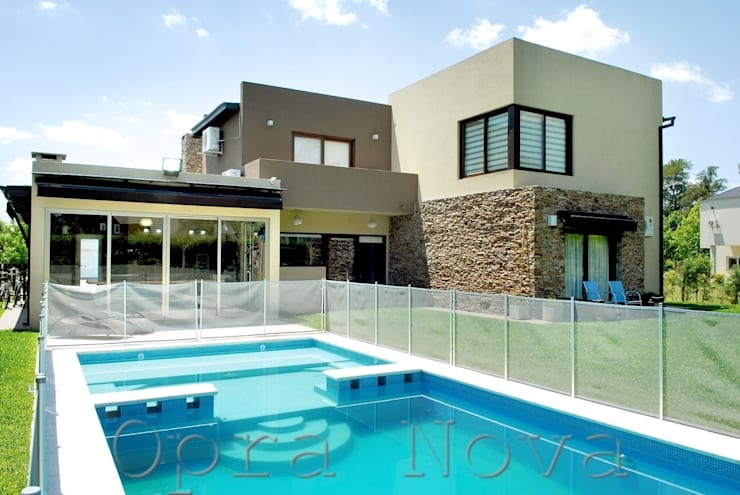 Fachada Contrafrente: Casas de estilo  por Opra Nova - Arquitectos - Buenos Aires - Zona Oeste