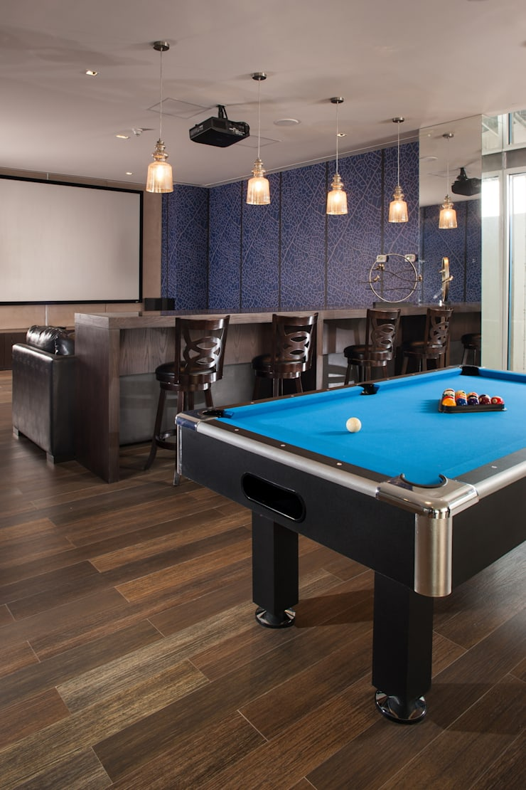 TV Room y Sala de Juegos : Salas de estilo  por UNUO Interiorismo