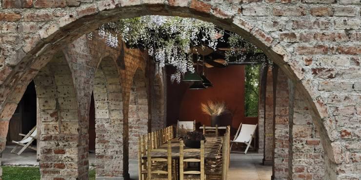Jardins de inverno rústicos por Bórmida & Yanzón arquitectos
