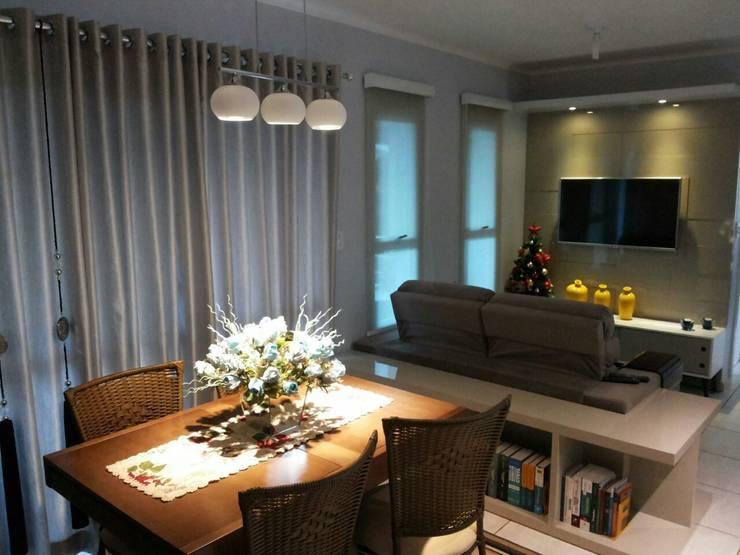 Apartamento: Salas multimídia  por Daiana Pasqualon Arquitetura & Lighting,