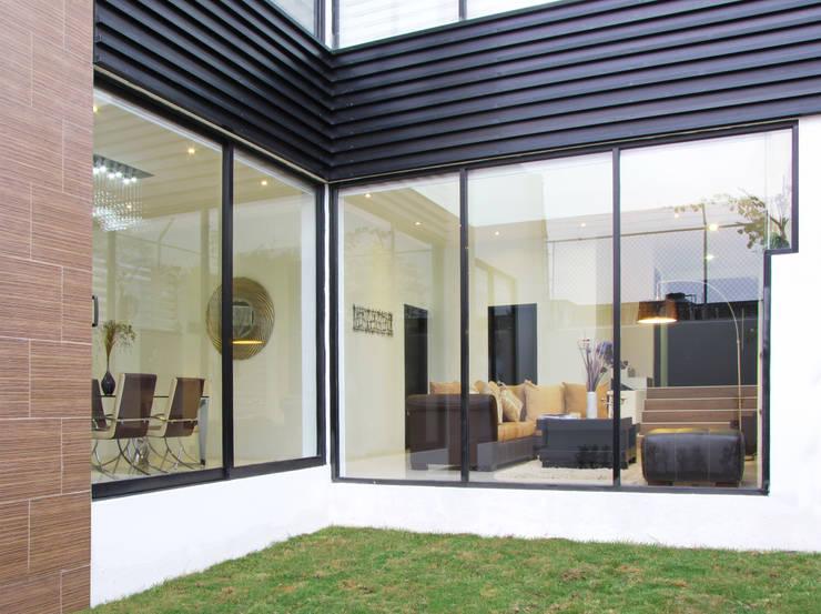 Projekty,  Domy zaprojektowane przez Estudio Meraki
