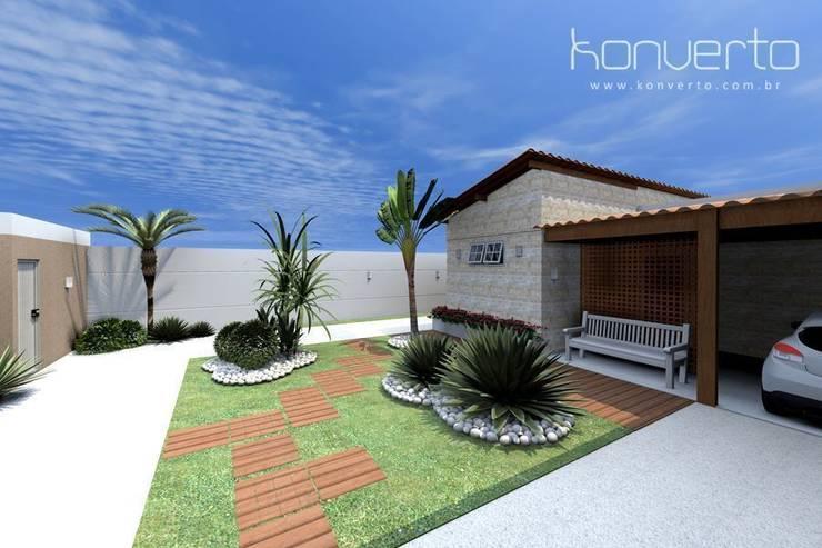 Espaço Gourmet, piscina e fachada – Residência RJ: Casas  por Konverto Interiores + Arquitetura