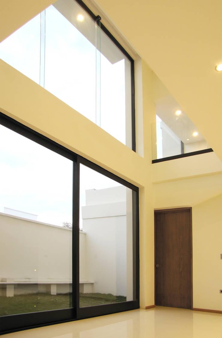 Vista Interior - Doble Altura : Salas de estilo  por Estudio Meraki