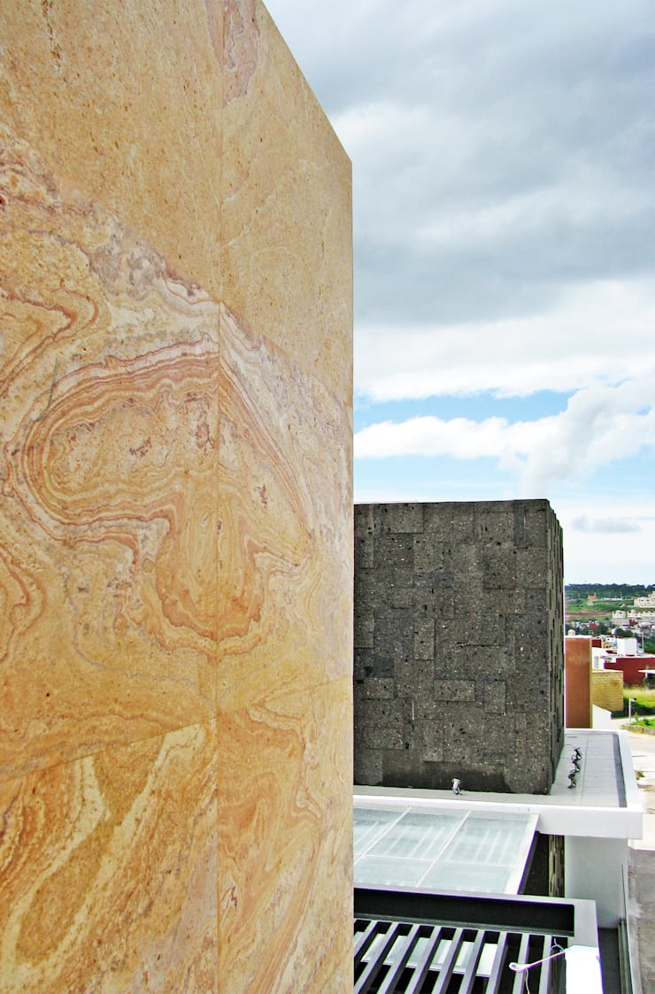 Detalle de Piedra Cantera: Paredes de estilo  por Estudio Meraki