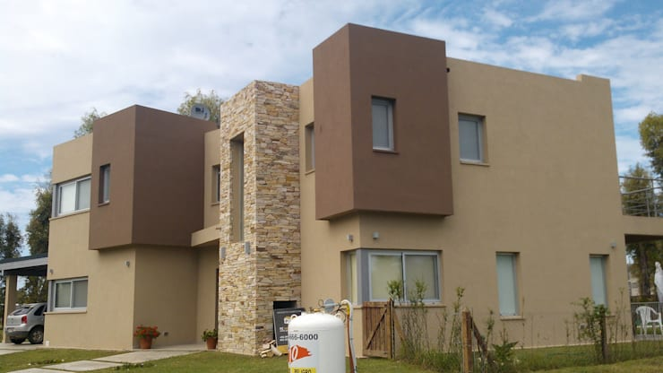 Casa en Barrio Cerrado: Casas de estilo moderno por Grupo PZ
