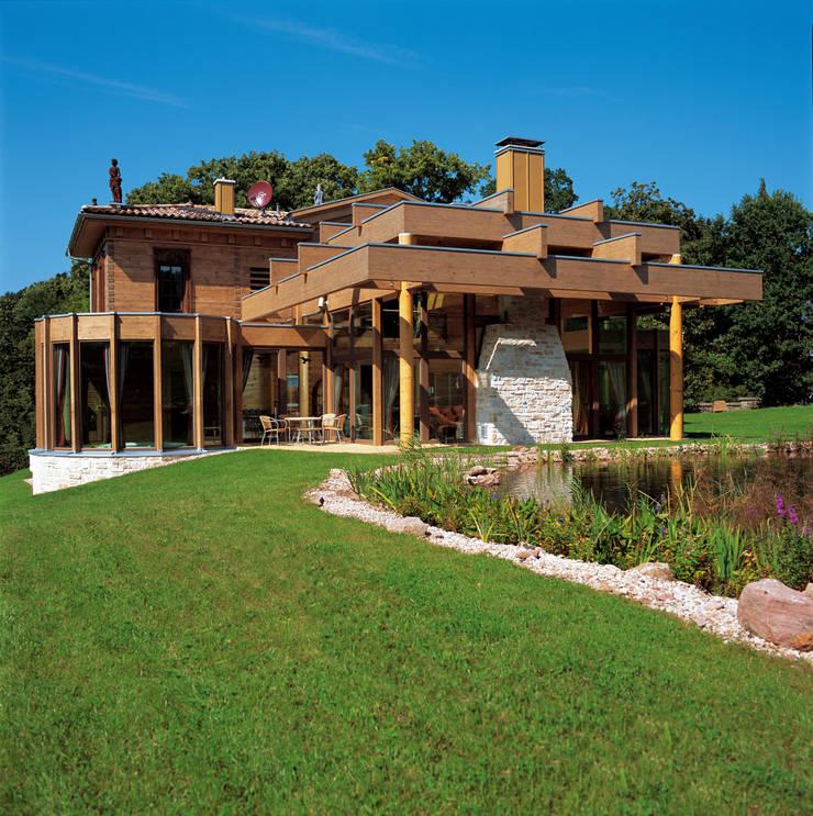 Rustic style house by ELK Fertighaus GmbH Rustic