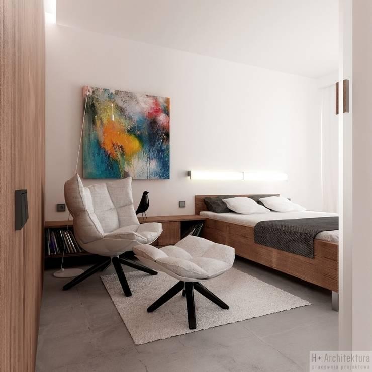Dormitorios de estilo  por H+ Architektura