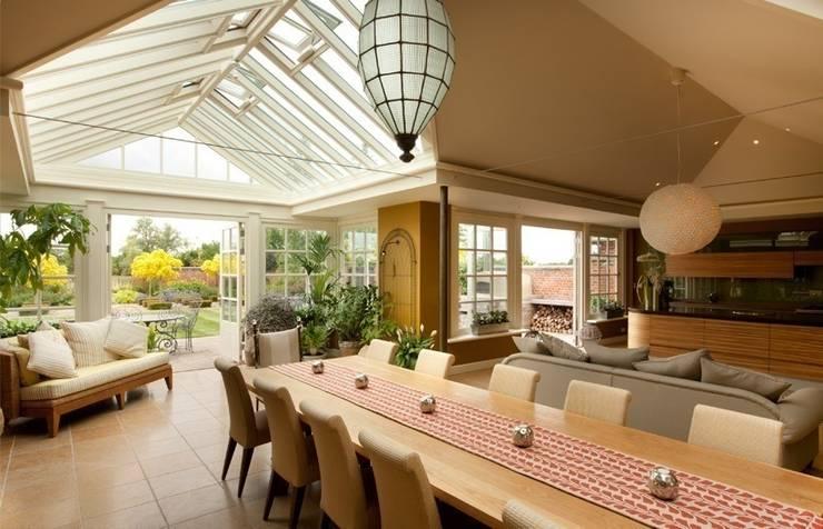 Extension interior: modern Conservatory by Westbury Garden Rooms
