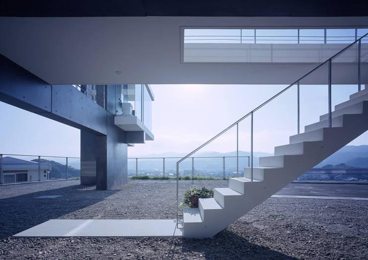 中山の住宅: アトリエ環 建築設計事務所が手掛けた廊下 & 玄関です。,