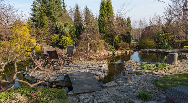 Wyspa wczesną wiosną: styl , w kategorii Ogród zaprojektowany przez Centrum ogrodnicze Ogrody ResGal