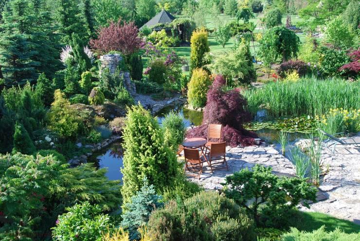 Lato na wyspie: styl , w kategorii Ogród zaprojektowany przez Centrum ogrodnicze Ogrody ResGal