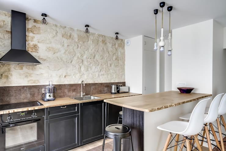 Appartement parisien: Cuisine de style de style Industriel par Meero