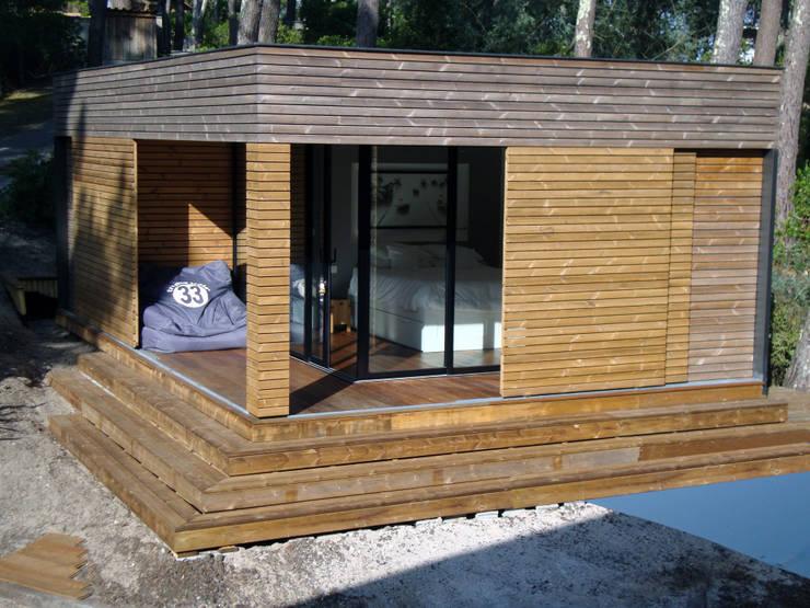Maison ossature bois : Maisons de style  par Clemence de Mierry Grangé