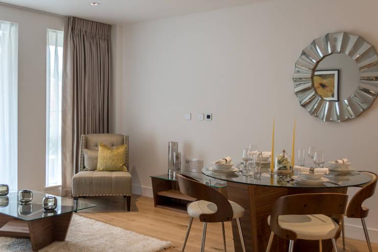 Lounge area Salones de estilo moderno de In:Style Direct Moderno
