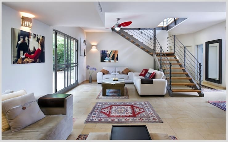 Casa de Isi: Salones de estilo  de Capital Conceptual
