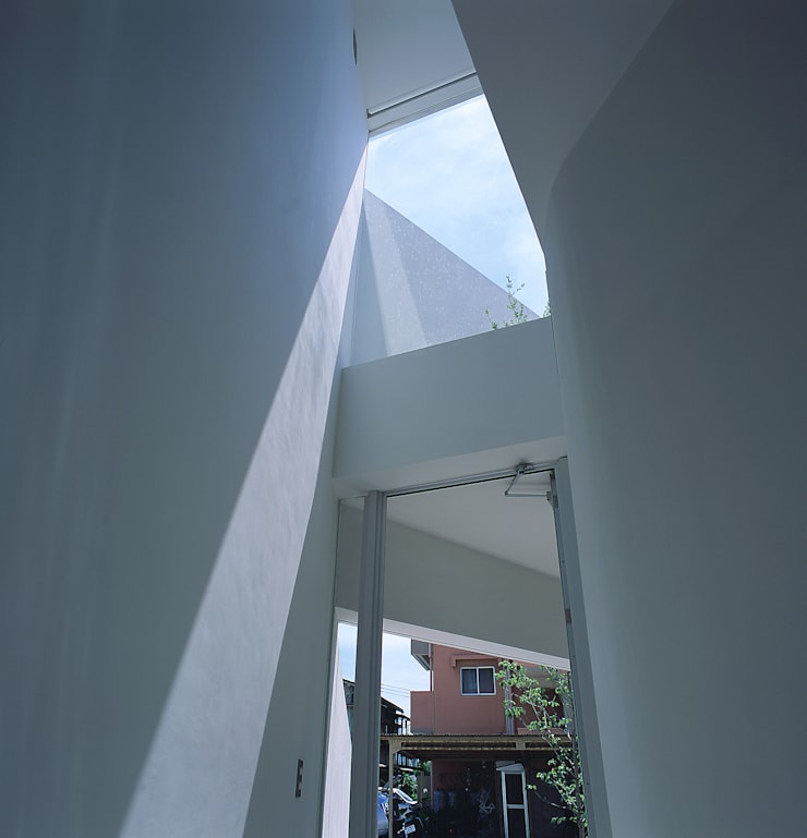 宇宿の住宅: アトリエ環 建築設計事務所が手掛けた廊下 & 玄関です。