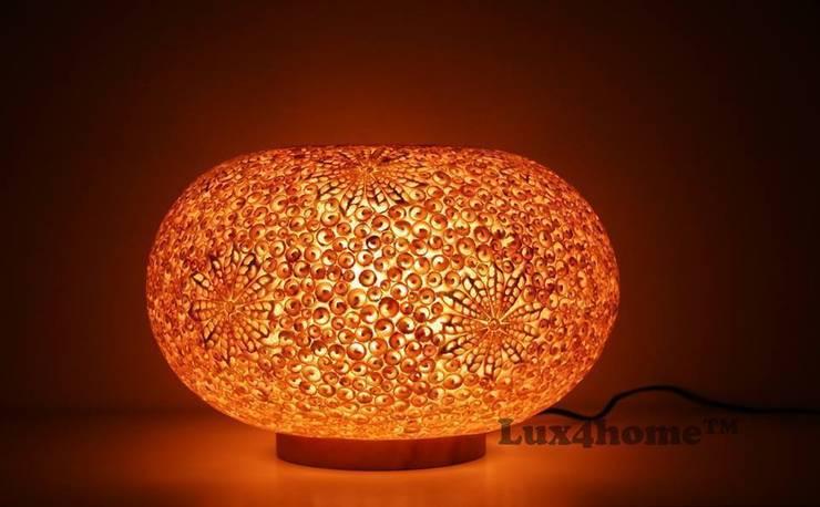Lampy dekoracyjne: styl , w kategorii Domowe biuro i gabinet zaprojektowany przez Lux4home™