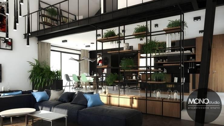 Nowoczesny dom o bardzo ciekawej formie, którego wnętrza korespondują z zewnętrzem.: styl , w kategorii Salon zaprojektowany przez MONOstudio,Nowoczesny