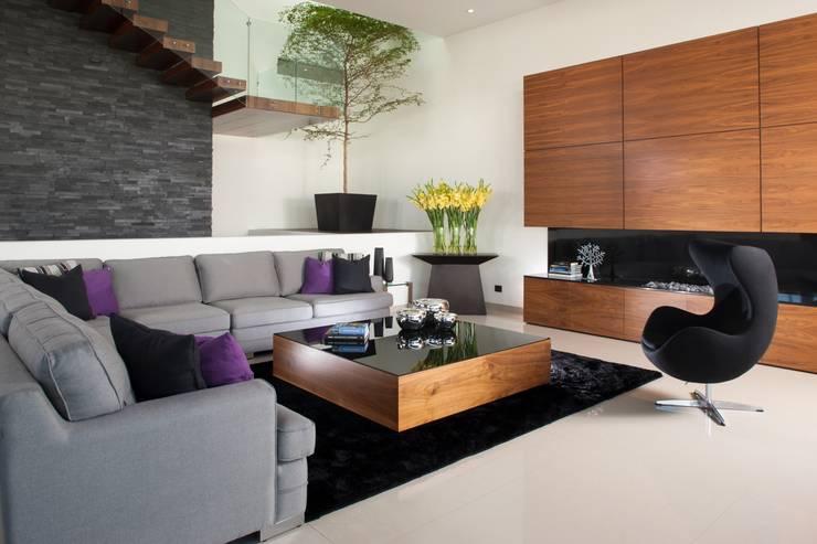 Casa GM Salones modernos de GLR Arquitectos Moderno