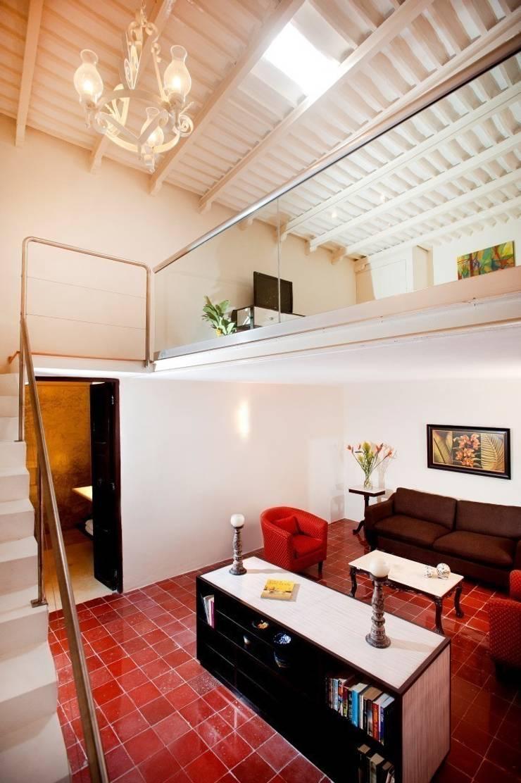 Suite: Hoteles de estilo  por Taller Estilo Arquitectura