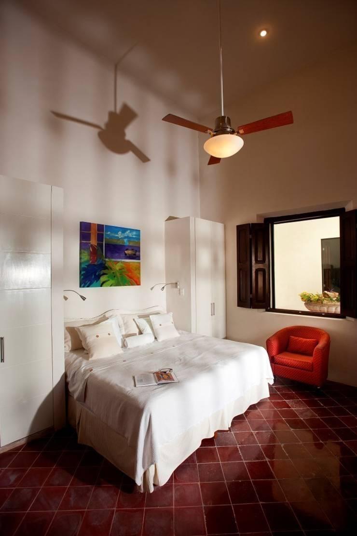 Dormitorio: Hoteles de estilo  por Taller Estilo Arquitectura