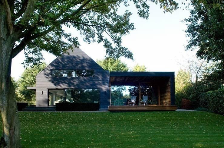 Garten und Fassaden: moderne Häuser von Paul Marie Creation