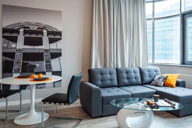 Salon z aneksem jadalnianym: styl , w kategorii Salon zaprojektowany przez KODO projekty i realizacje wnętrz