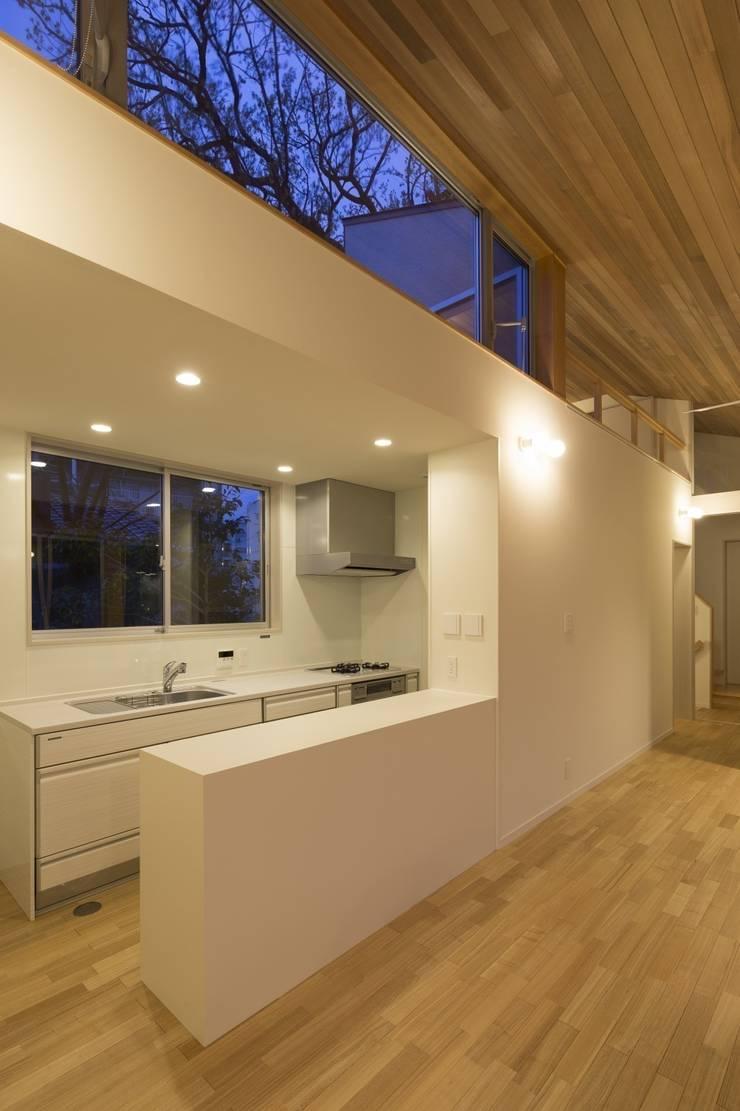 大府の二世帯住宅: 株式会社FAR EAST [ファーイースト]が手掛けたキッチンです。,和風