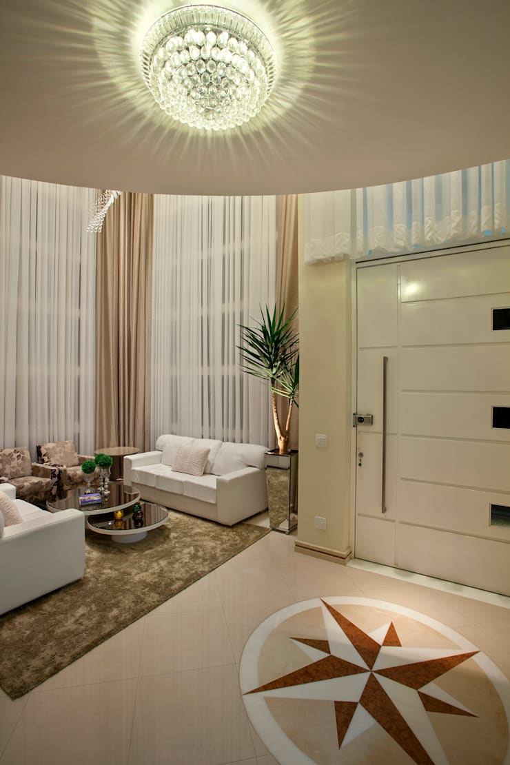 Casa Porto Seguro: Salas de estar  por Arquiteto Aquiles Nícolas Kílaris
