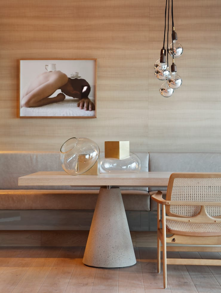 LOFT 212: Sala de jantar  por Yamagata Arquitetura