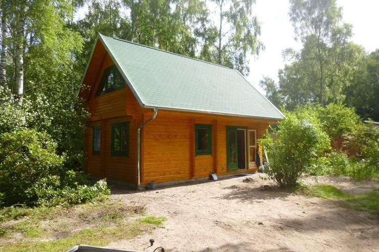 rustic Houses by THULE Blockhaus GmbH