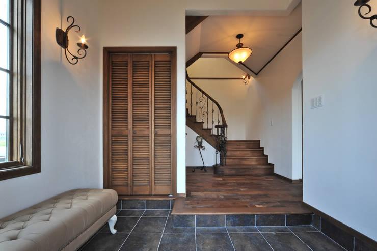玄関.*: 株式会社 盛匠が手掛けた壁です。