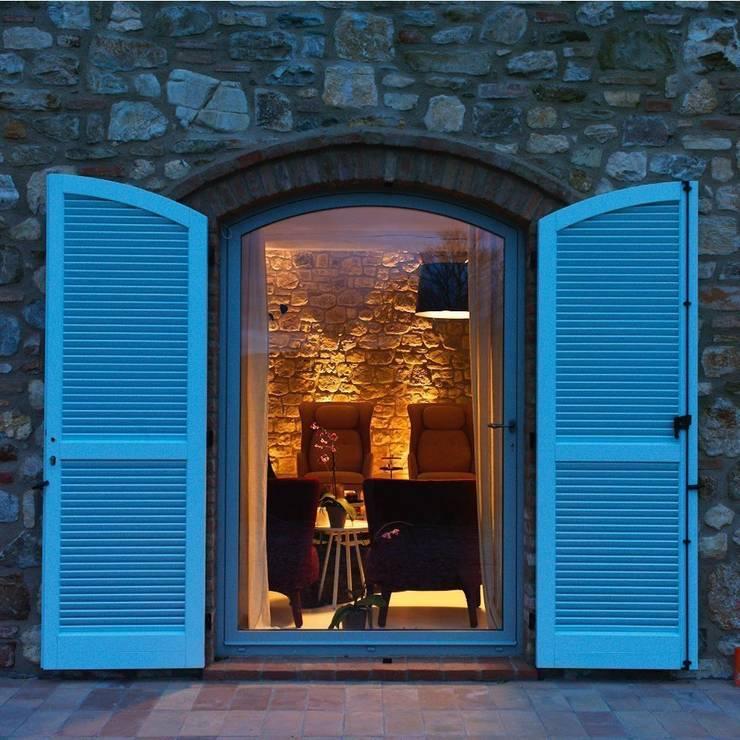 Locanda di Doris: Case in stile in stile Minimalista di CASABELLA