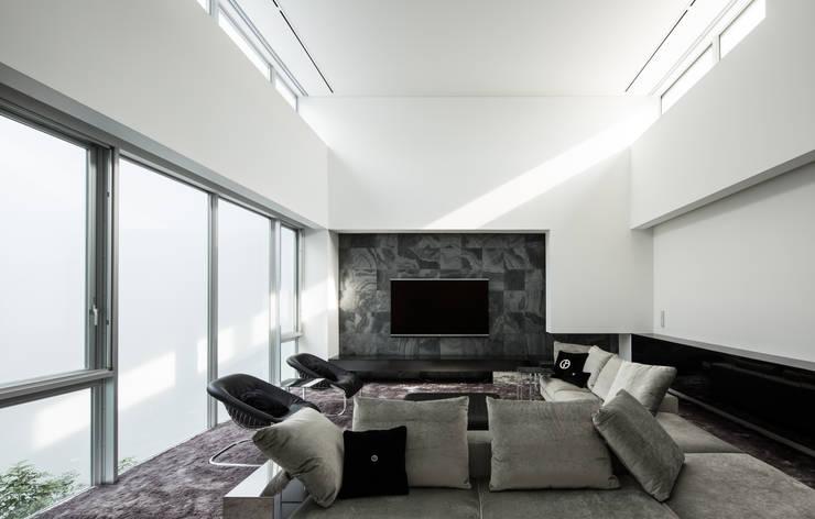 姫島の家: Abax Architectsが手掛けたリビングです。