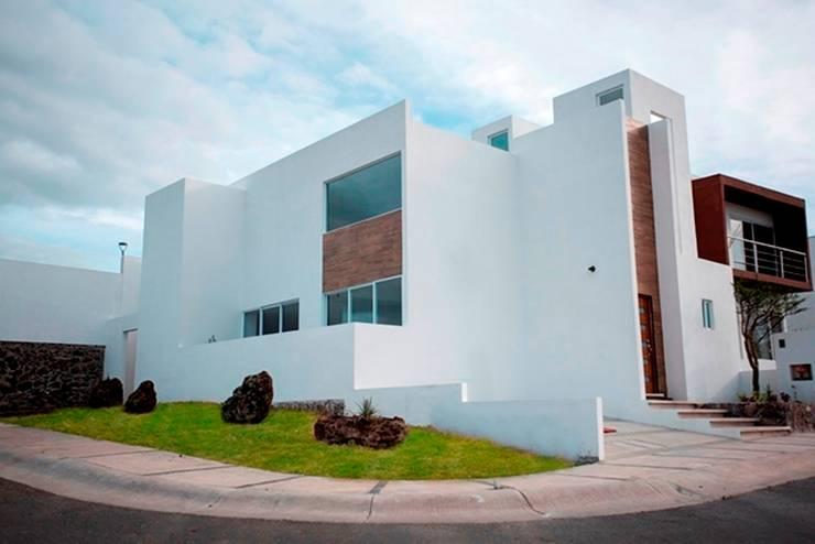 Fachada: Estudios y oficinas de estilo  por JF ARQUITECTOS