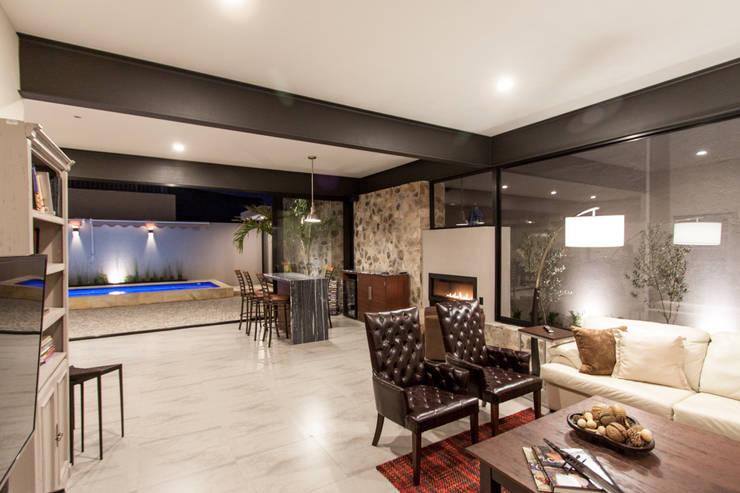 CASA PAULIN: Salas de estilo  por Cambio De Plano