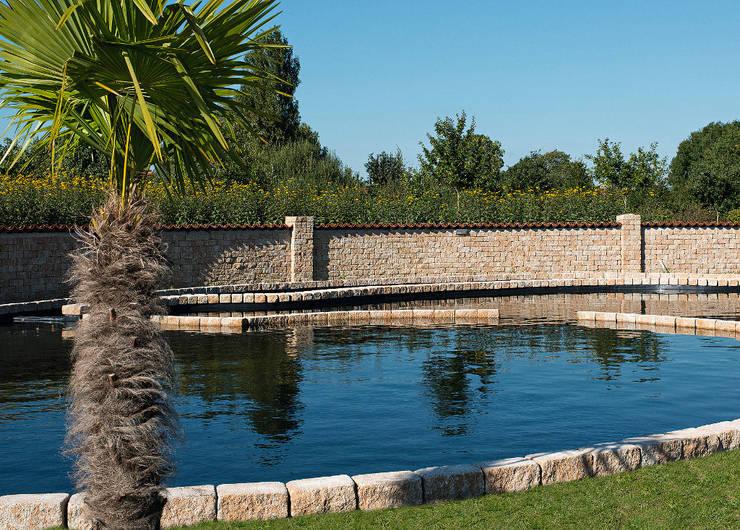 สวน by Rimini Baustoffe GmbH